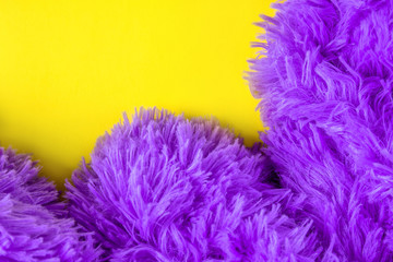 Blue fluffy carpet on a yellow background