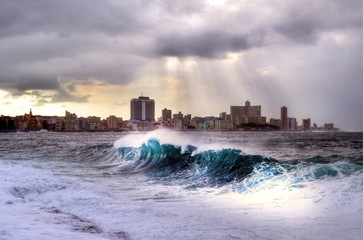 Stormy weather hitting The Malecon in Havana, waves crash over the protective seawall in these dramatic weather images, Cuba