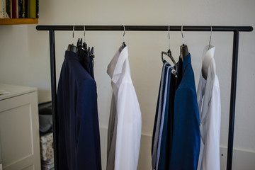 hanger with elegant men's clothes shirt and ties