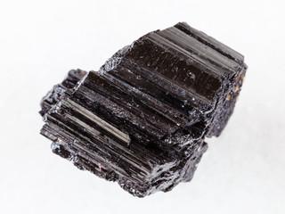 raw crystal of black Tourmaline (Schorl) on white