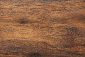 Wood background or dark brown texture. Texture of old wood use as natural background. Top view of brown black american walnut wood paneling. Copy space