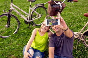 young couple in love taking selfie in the park.