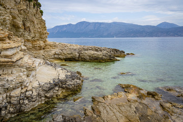 Desimi Beach Golf and nearby Island with clear water in Greece