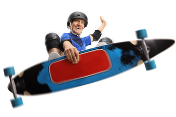 Elderly man wearing protective equipment jumping with a longboard