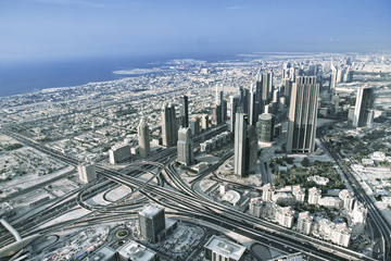 Aerial view. Dubai skyline with beautiful city close to it's busiest highway