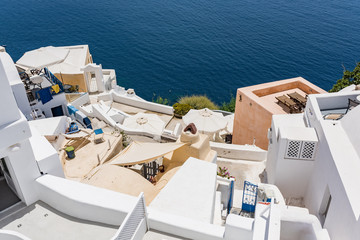Tiny little white houses and hotels in the Oia village at Santorini, Greece.