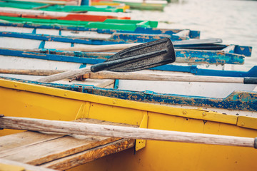 Wooden boat oars and boats as a holiday concept