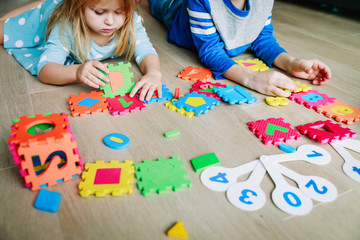 kids learning numbers, calculations, play with puzzle