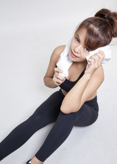 woman drinking water holding  towel around