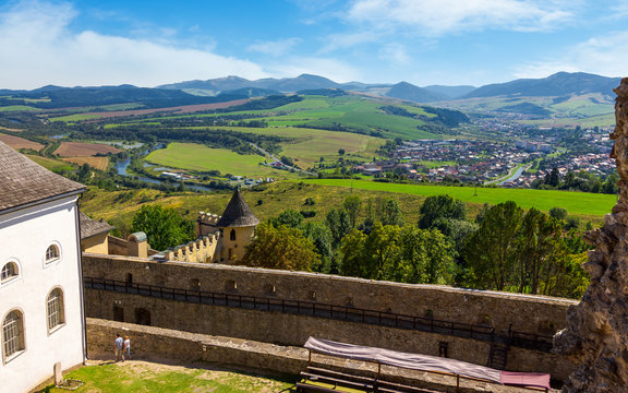 Stara Lubovna, Slovakia - AUG 28, 2016: Stara Lubovna castle above the valley of old town. popular tourist destination. Bright sunny day with mountains in the distance. view from the top.