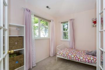 Amazing girl's bedroom in pink tones.