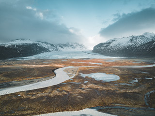 Vatnajokull glacier aerial drone image with street highway and clouds and blue sky. Dramatic winter scene of Vatnajokull National Park, Iceland, Europe. Beauty of nature concept background.