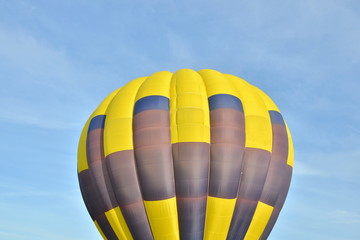 Close up of a colorful air balloon in blue sky.
