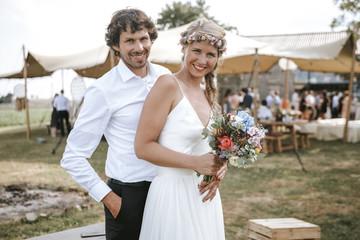 bride and groom on outdoor boho wedding