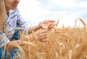 Young agronomist in grain field. Cereal farming
