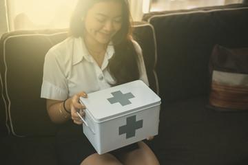 Woman holding a medicine box.