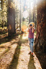 Young Girl Taking Photos in the Forest