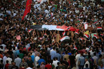 People gather during a protest in the city of Najaf