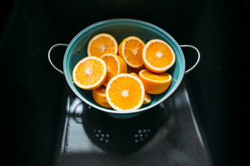 Cut Oranges in Strainer