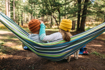 Siblings in Hammock in Forest