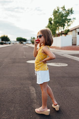 Girl Eating Apple in Street