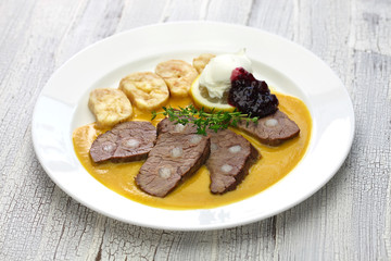 svickova na smetane ( beef in sour cream sauce) served with knedlik (bread dumpling), traditional Czech cuisine