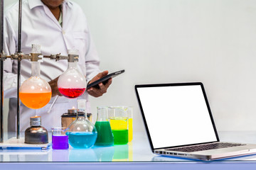 a scientist work on computer in chemical mixing in laboratory experiments with copy space
