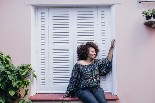 Woman sitting in window