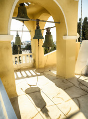 A bell on the rooftop of a church at Oia, Santorini, Greek Islands