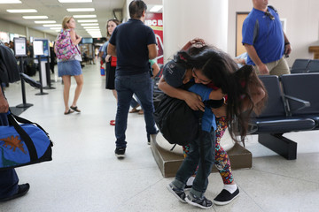 An asylum seeker from Honduras is reunited with her five-year-old son at Brownsville South Padre International Airport in Brownsville