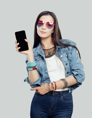 Young woman with smartphone showing empty display