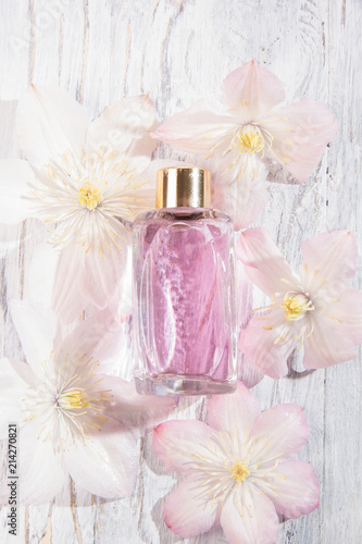 Perfume Bottles And White Flowers Stock Photo And Royalty Free