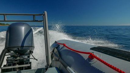Cruising in a RIB (rigid inflatable boat) on a sunny day