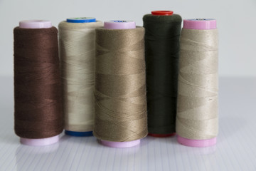 colorful bobbin on the white background for textile concept.