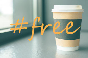 A cardboard Cup of coffee on the coffee windowsill with a hashtag is free of Charge Wall mural