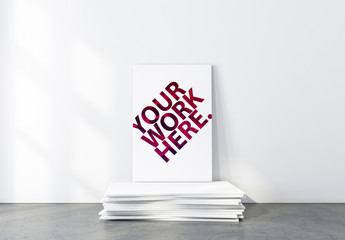 Canvas on Stack of Blank Canvases Mockup