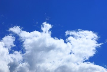 big gray white clouds against blue sky