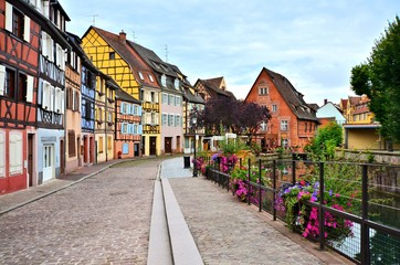 Fototapete - Colorful half timbered houses along a canal in the city of Colmar, Alsace, France