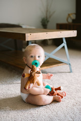 Adorably Cute Happy Baby Boy Playing with Blanket and Toys at Home and Smiling for Camera