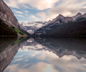 Mountain, glacier and water reflections at the Lake Louise, Banff National Park