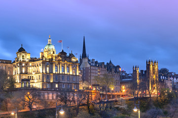 Cityscape in old town district of Edinburgh City being lit up at night in central Edinburgh, Scotland, UK
