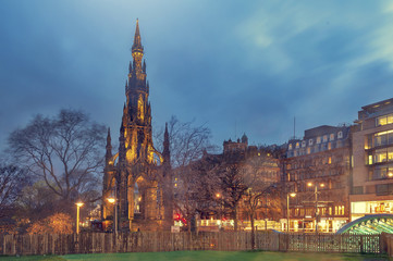 The Victorian Gothic building of Scott Monument to Scottish author, Sir Walter Scott, in Princes Street Gardens in old town Edinburgh, Scotland, UK, being lit up at night