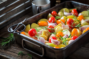 Fresh grilled tasty potato with garlic, rosemary and tomatoes