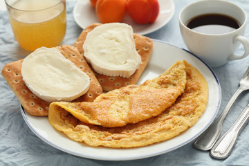 Breakfast with omelet and goat cheese