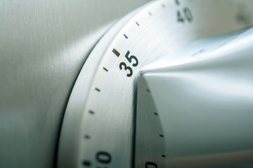 35 Minutes - Analog Chrome Kitchen Timer Placed On A Refrigerator