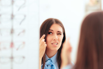 Woman Having Trouble Putting On Contact Lenses