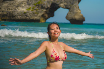 young beautiful and happy Asian Korean woman having fun smiling relaxed and cheerful in the sea having Summer holidays at tropical paradise island
