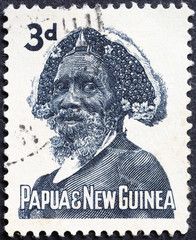 Native man of Papua new Guinea on old postage stamp