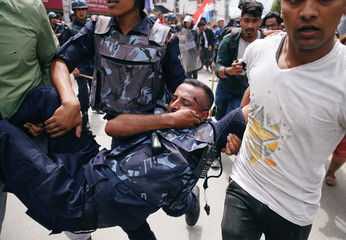 An injured police personal is carried during the protest organized by the Sister organizations of Nepali Congress Party the main opposition party to the government in Kathmandu