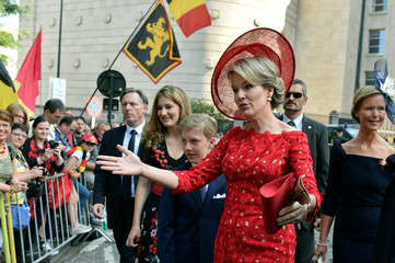 Belgium's Queen Mathilde, Prince Emmanuel and Crown Princess Elisabeth greet the crowd after a religious service on Belgian national day in Brussels